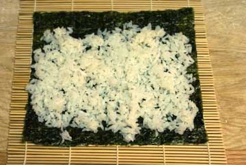 Rice on to make sushi rolls