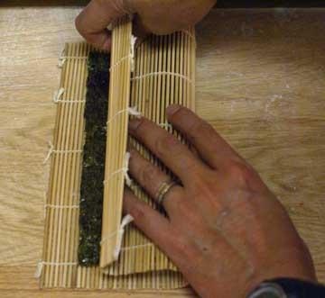 Fold the sushi mat for sushi rolls