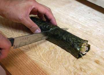 Cut the sushi roll in half
