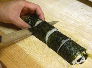 Cut sushi roll again into 4