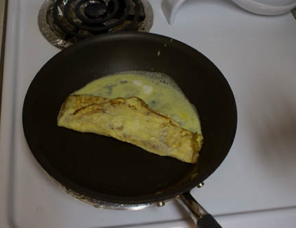 Egg in pan 5