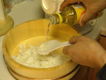 Pour vinegar over rice